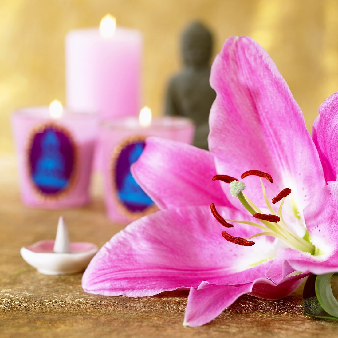 Pink lily and scented candles
