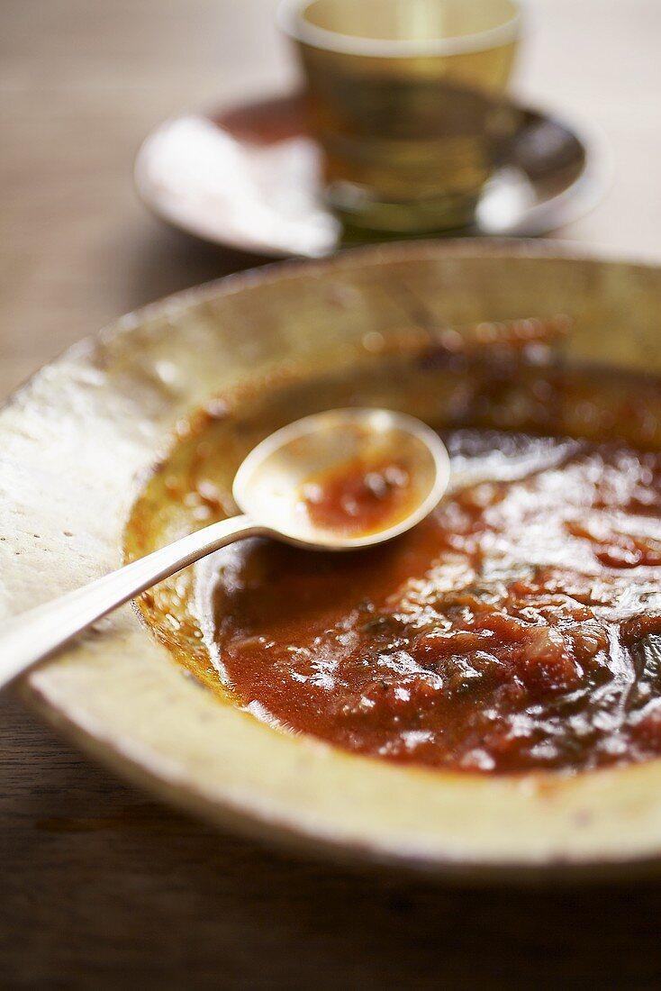 Half-eaten plate of tomato ragout