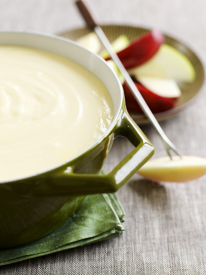 Cheese fondue with apple slices
