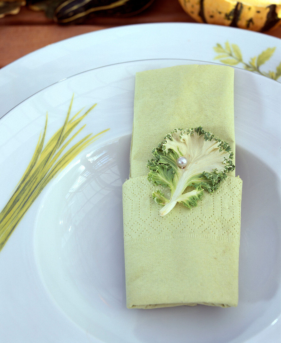 Napkin decorated with ornamental cabbage leaf
