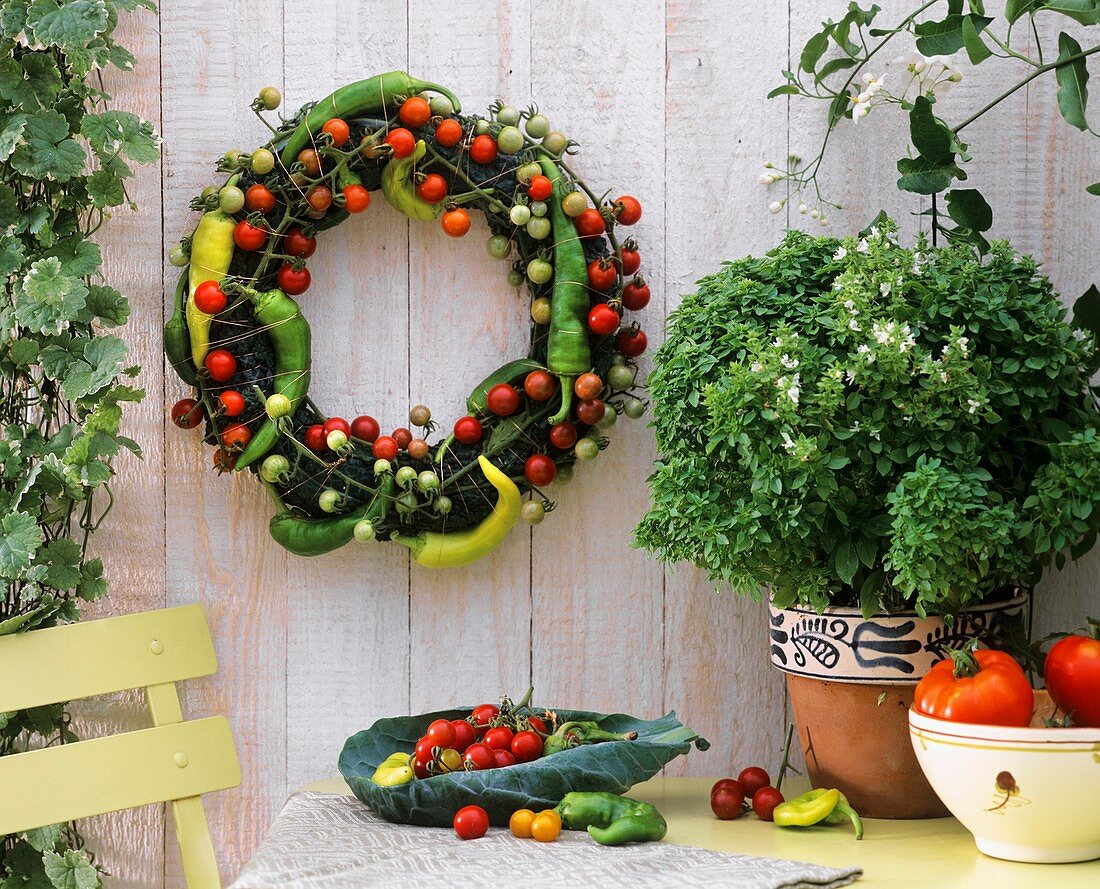 Wreath of cocktail tomatoes and chili peppers