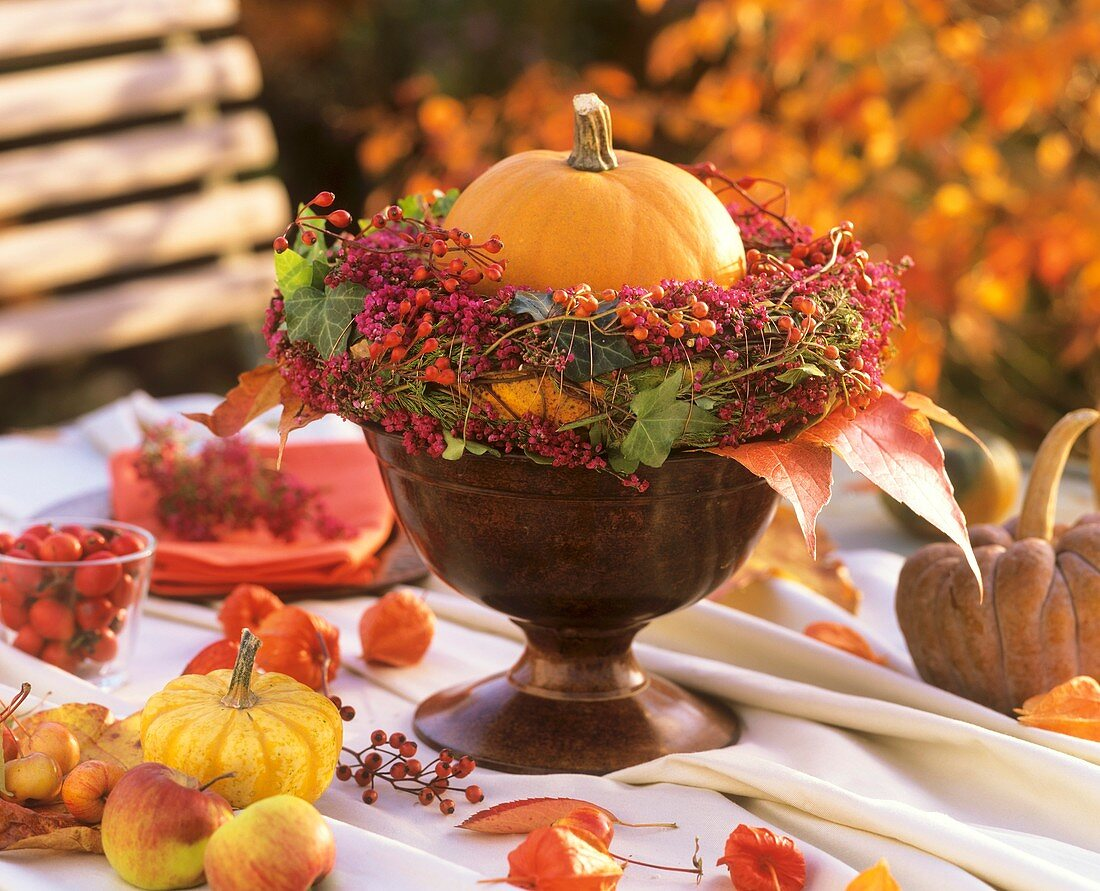 Autumn arrangement with pumpkin and berries