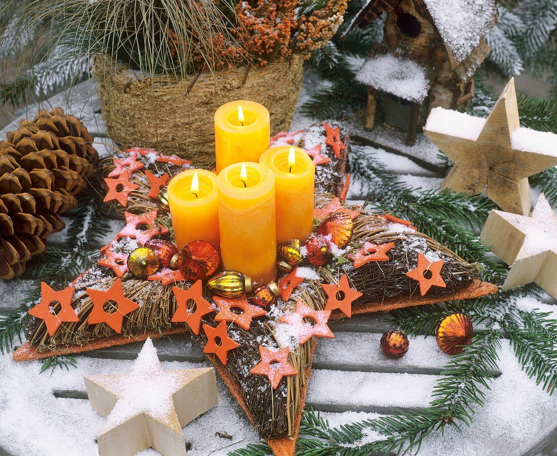Star-shaped Advent wreath in snow