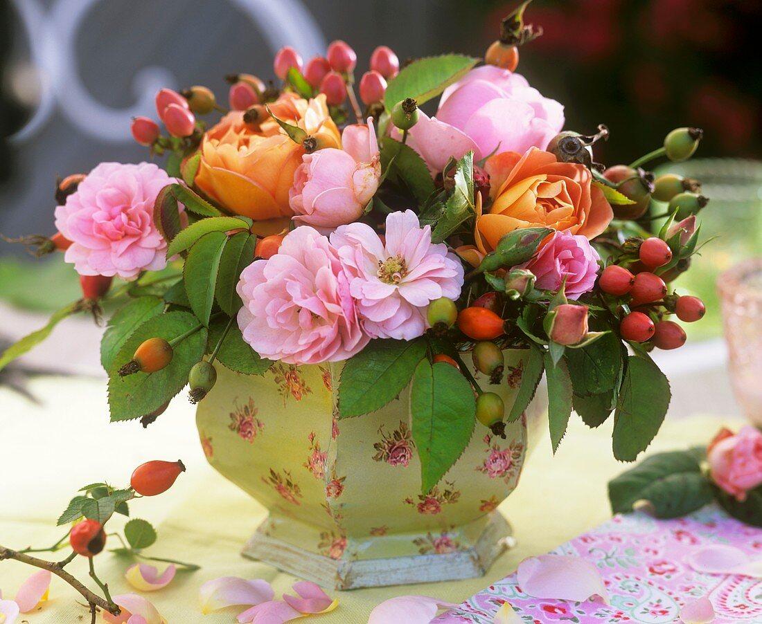 An arrangement of roses and Hypericum berries