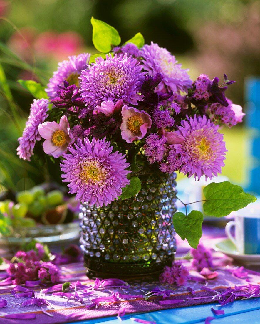 Vase of purple flowers