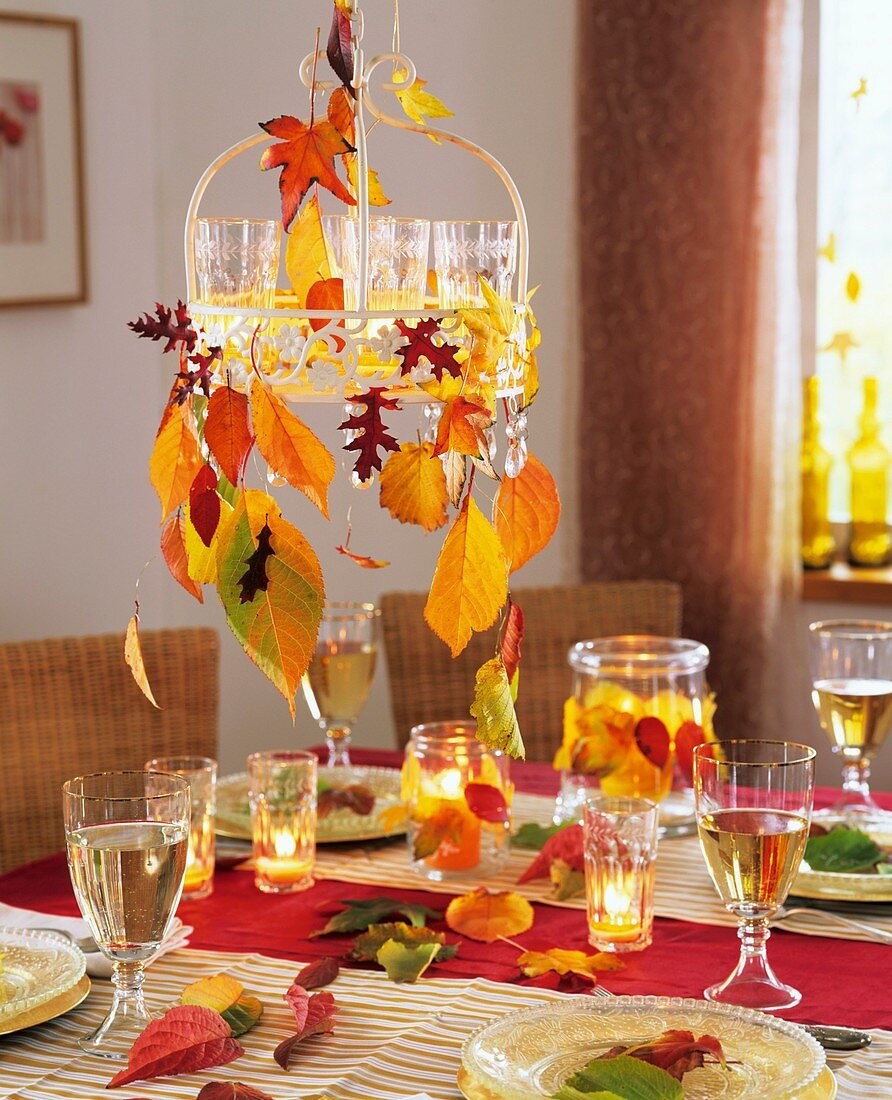 Hanging metal tray with tealights and autumn leaves