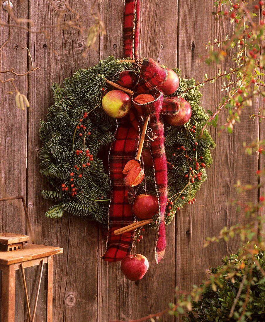 Door wreath with Noble fir, rose hips and ornamental apples