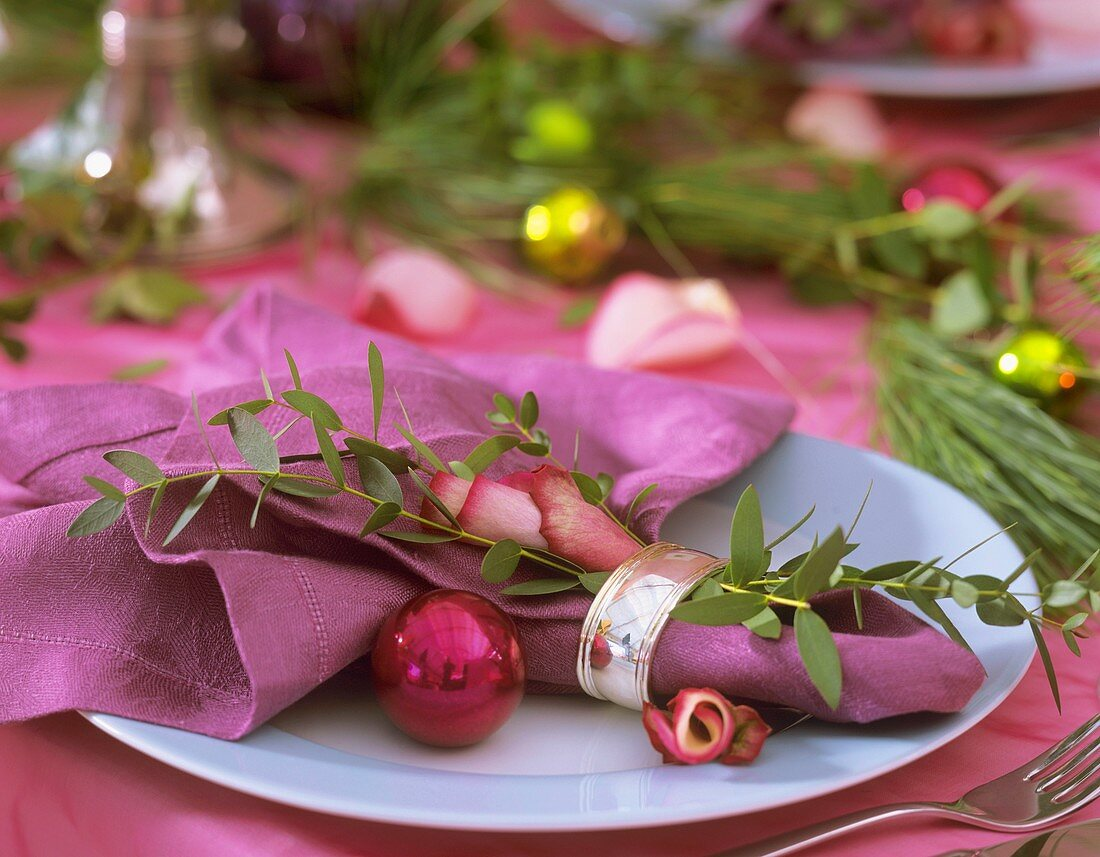 Place-setting with Eucalyptus, rose petals and tree baubles