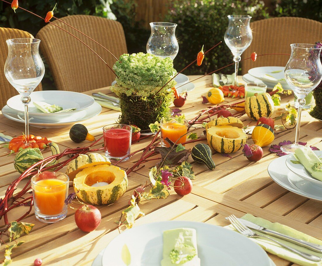 Autumnal table with ornamental cabbage and gourds