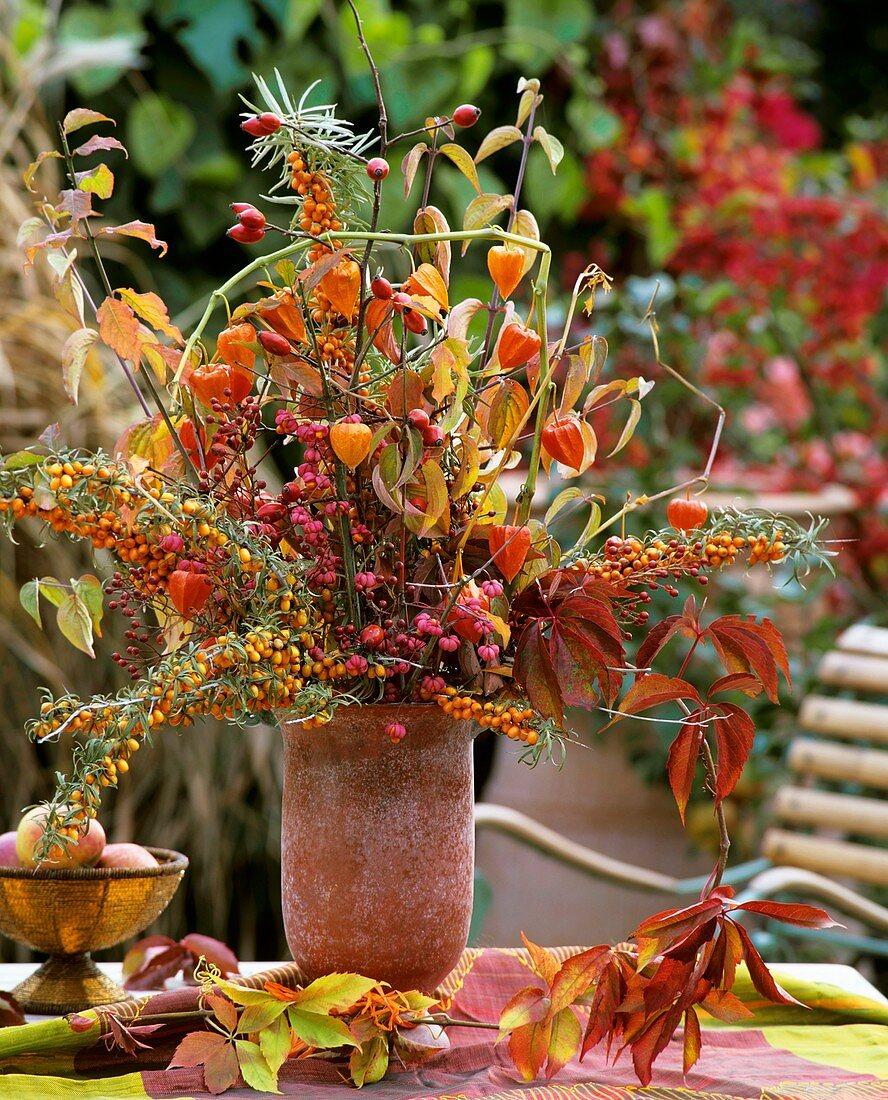 Autumn arrangement of sea buckthorn and European spindle