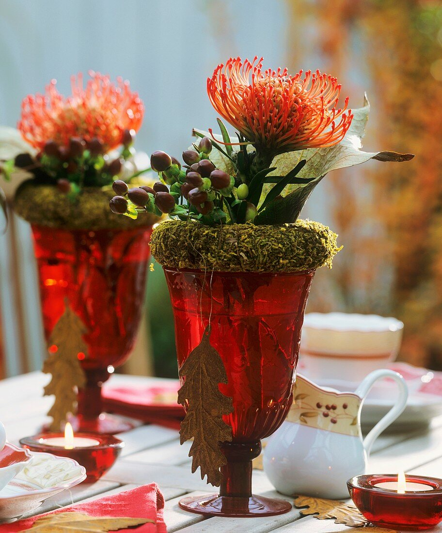 Wine glasses with moss wreath, Protea flower & Hypericum
