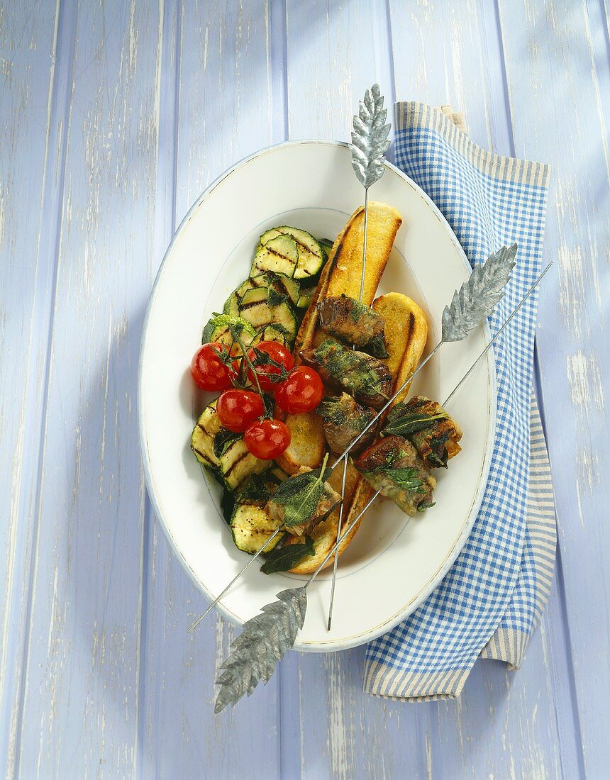 Calf's liver with pancetta on grilled bread, vegetables