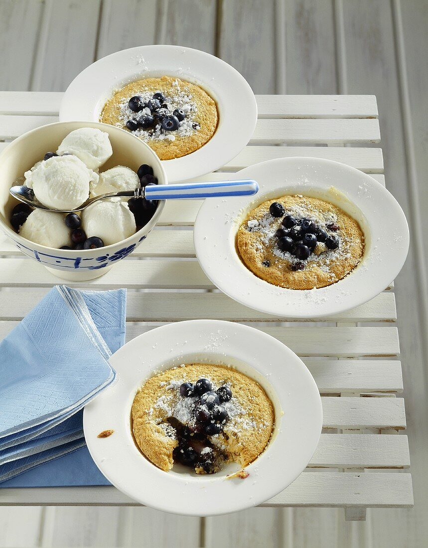 Blueberry almond puddings baked in plates, yoghurt ice cream