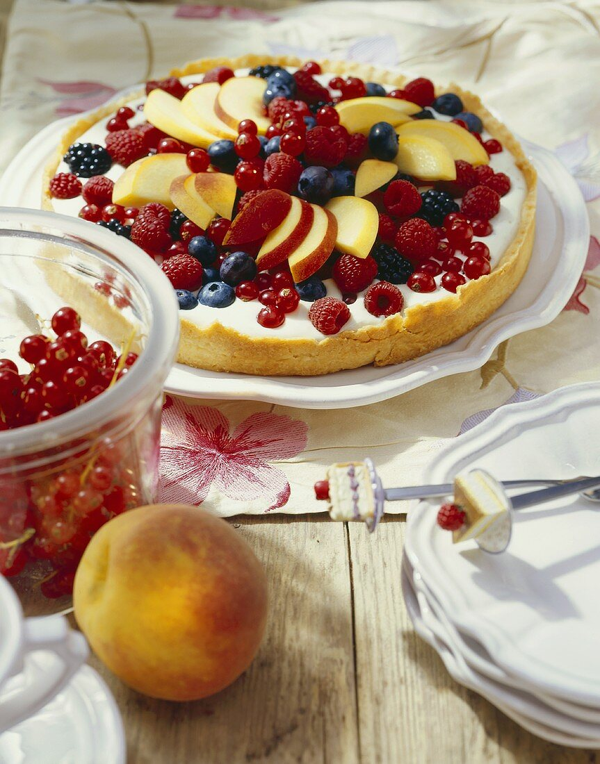 Berry and peach tart with coconut cream