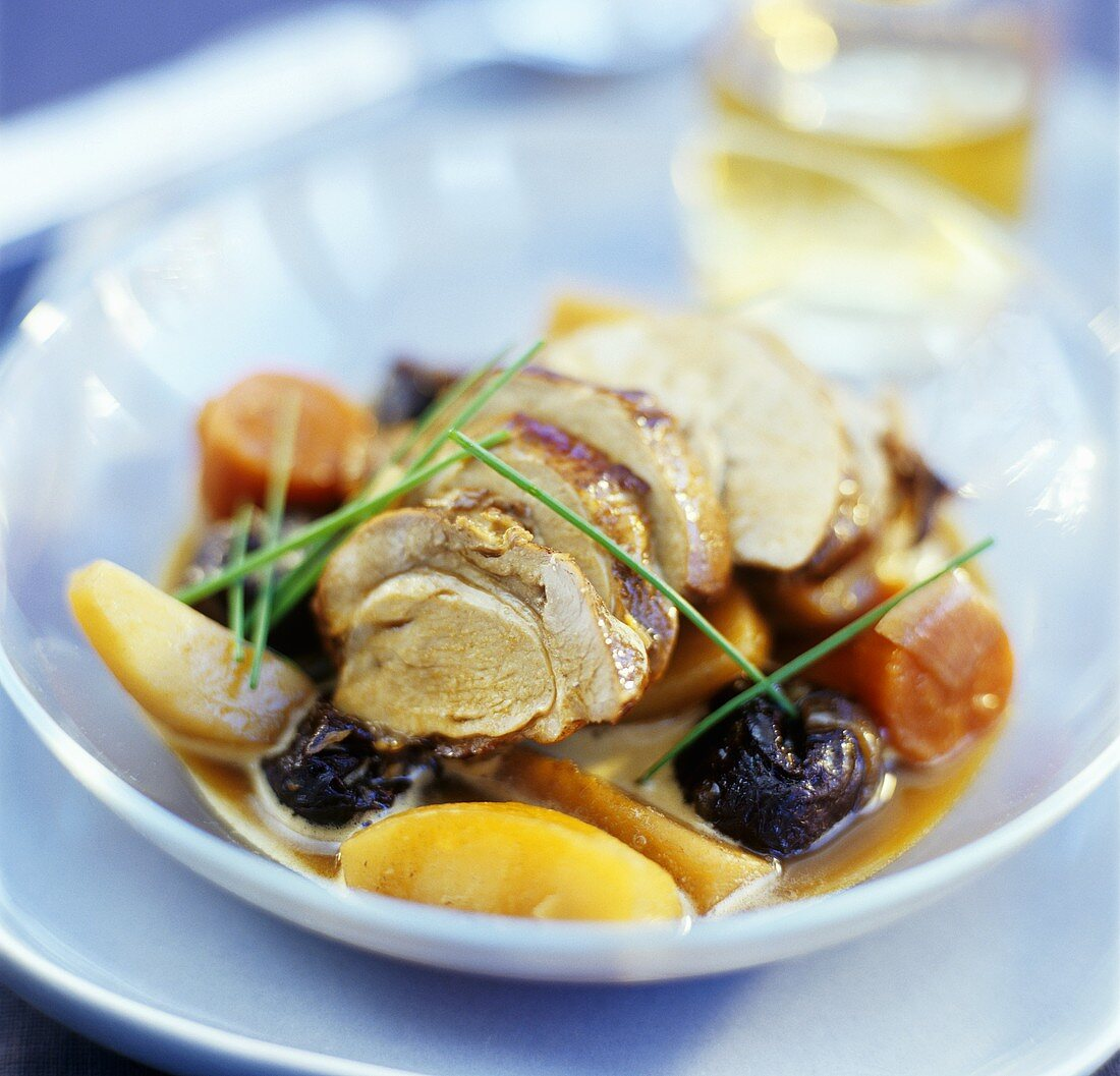 Wild boar with prunes and root vegetables in whisky sauce