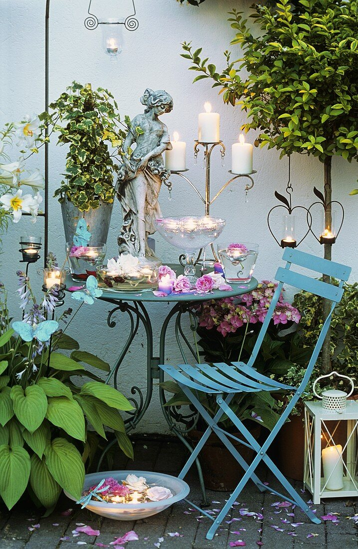 Table with candles and roses on a terrace