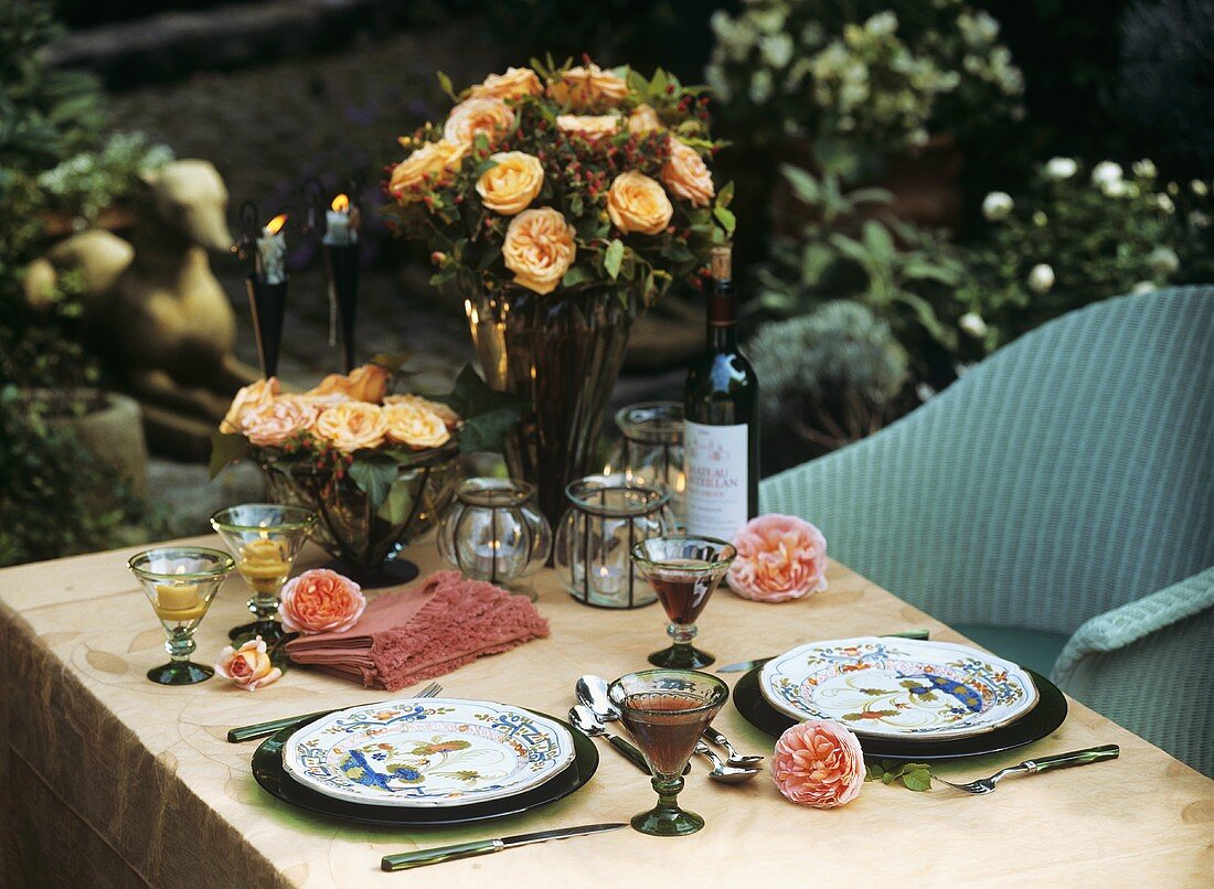 Table laid for two in a garden