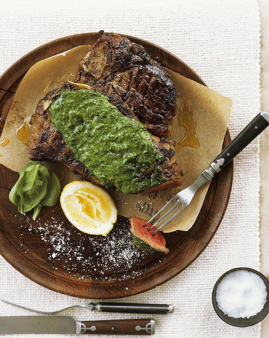 Bistecca alla fiorentina (T-bone steak with green sauce)