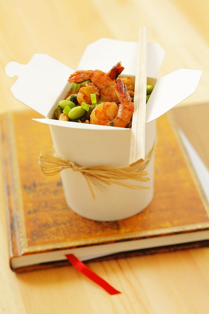 Prawns with soya beans and noodles in a take-away box