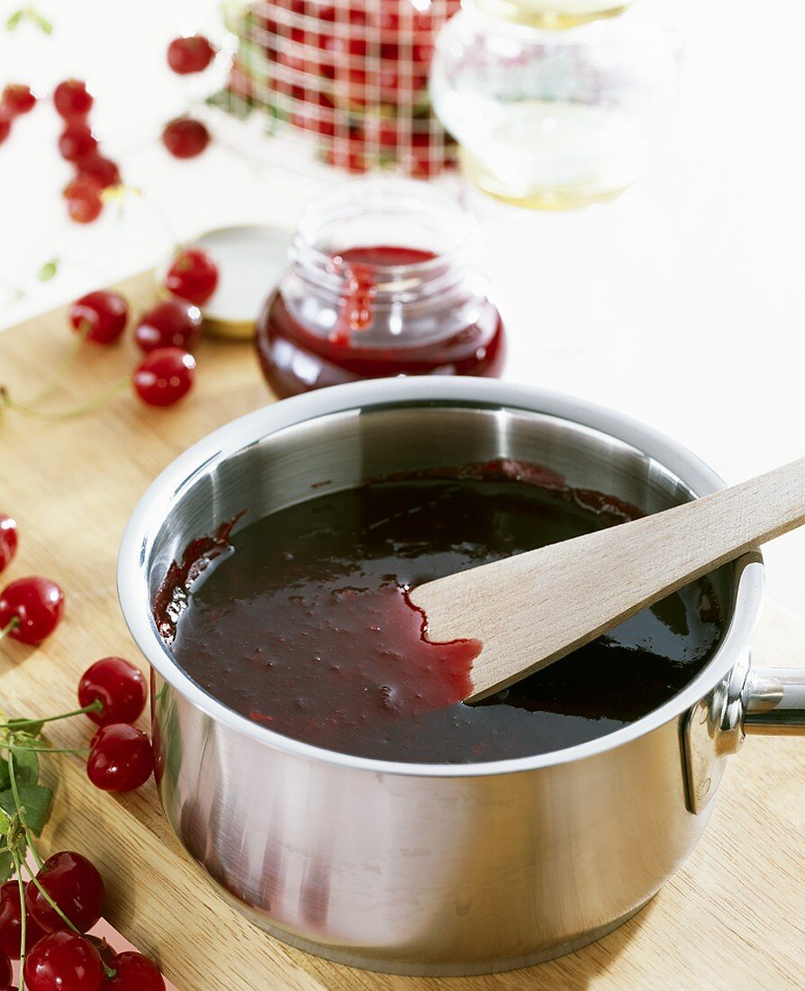 Making sour cherry and ginger jam