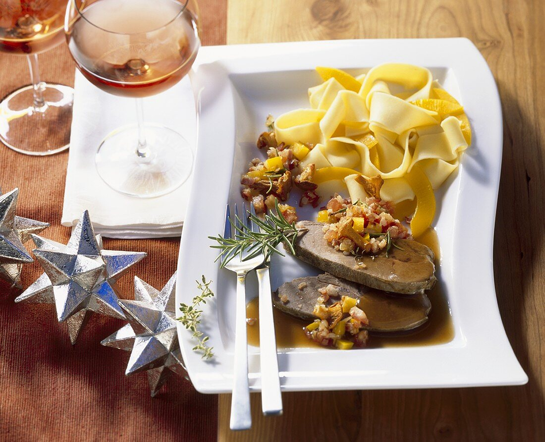 Roast wild boar with ribbon pasta and chanterelles