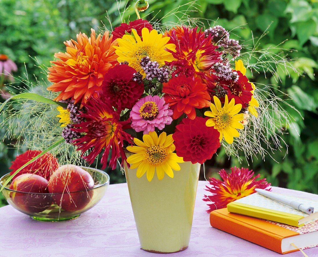 Vase of dahlias, zinnias, heliopsis, oregano and lovegrass