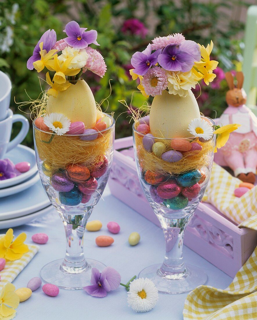 Easter decoration: posies in blown eggs in glasses