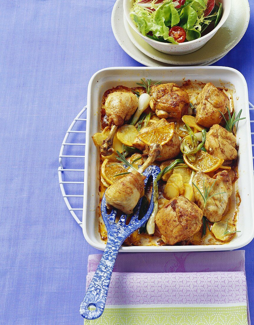 Chicken with oranges, potatoes and rosemary, oven-roasted