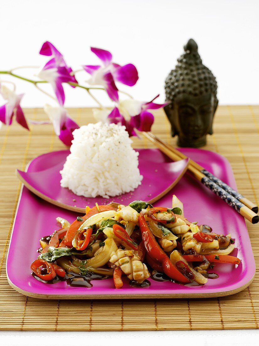 Thai chicken & vegetable stir-fry with rice & purple orchid