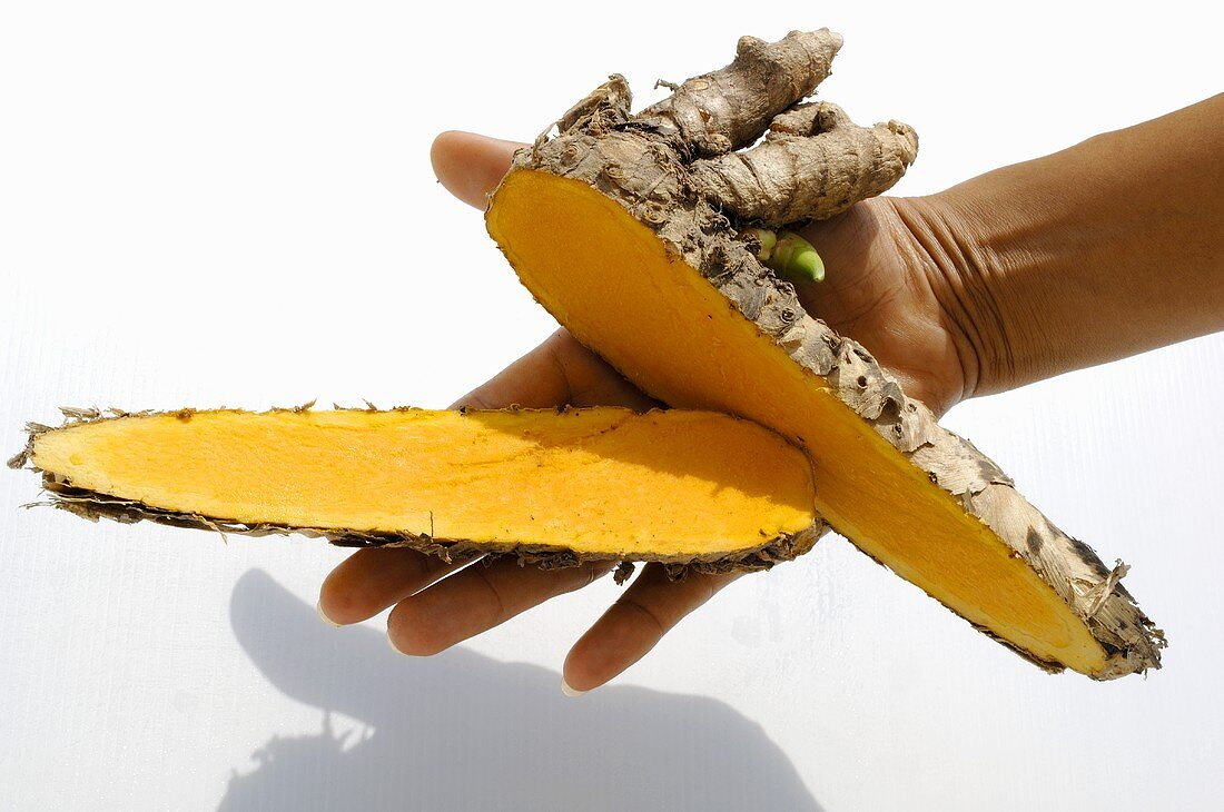 Hand holding a lesser yam (Thailand)