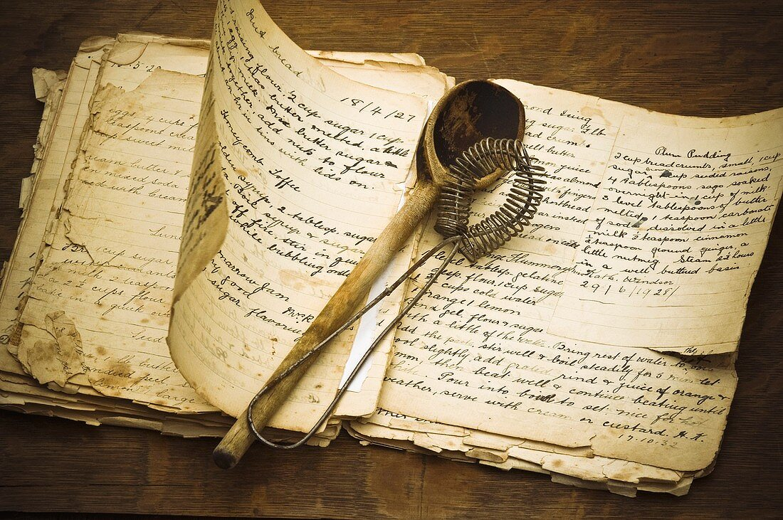 Old recipe book and kitchen utensils