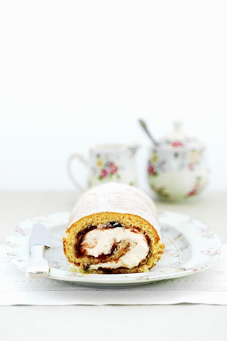 Sponge roll with cream and jam filling