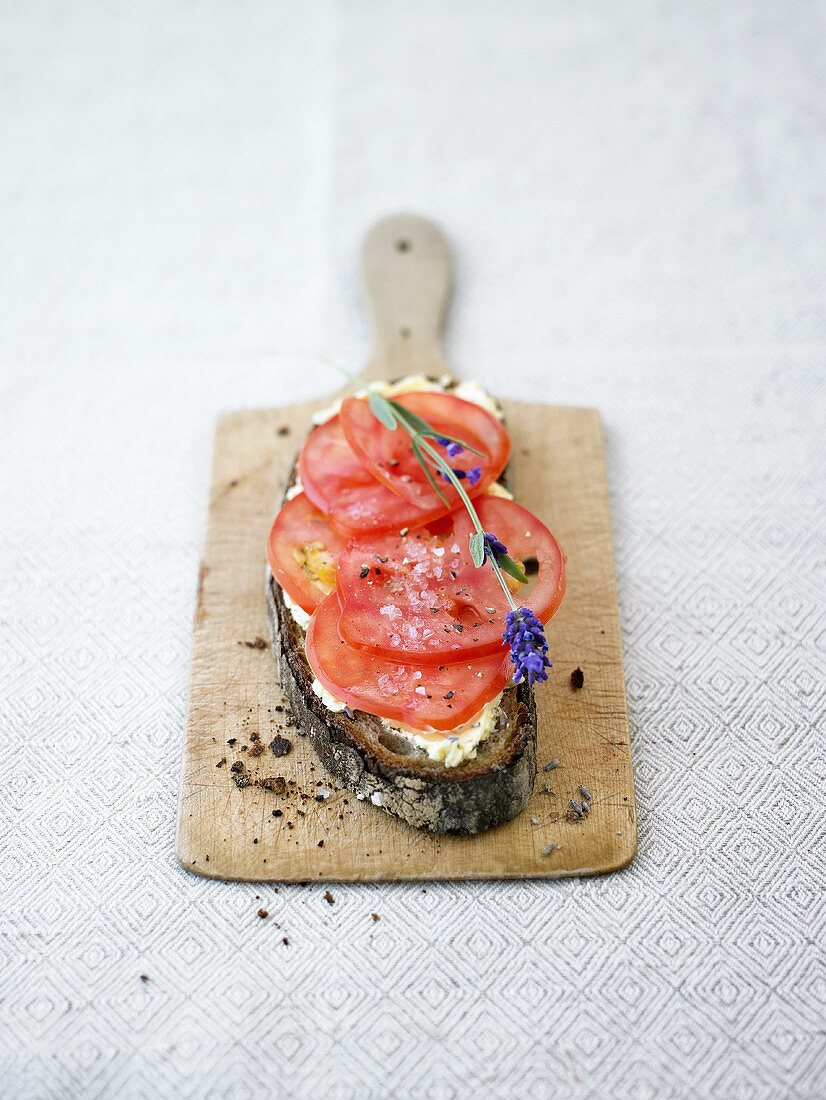 Tomato slices on bread with lavender butter