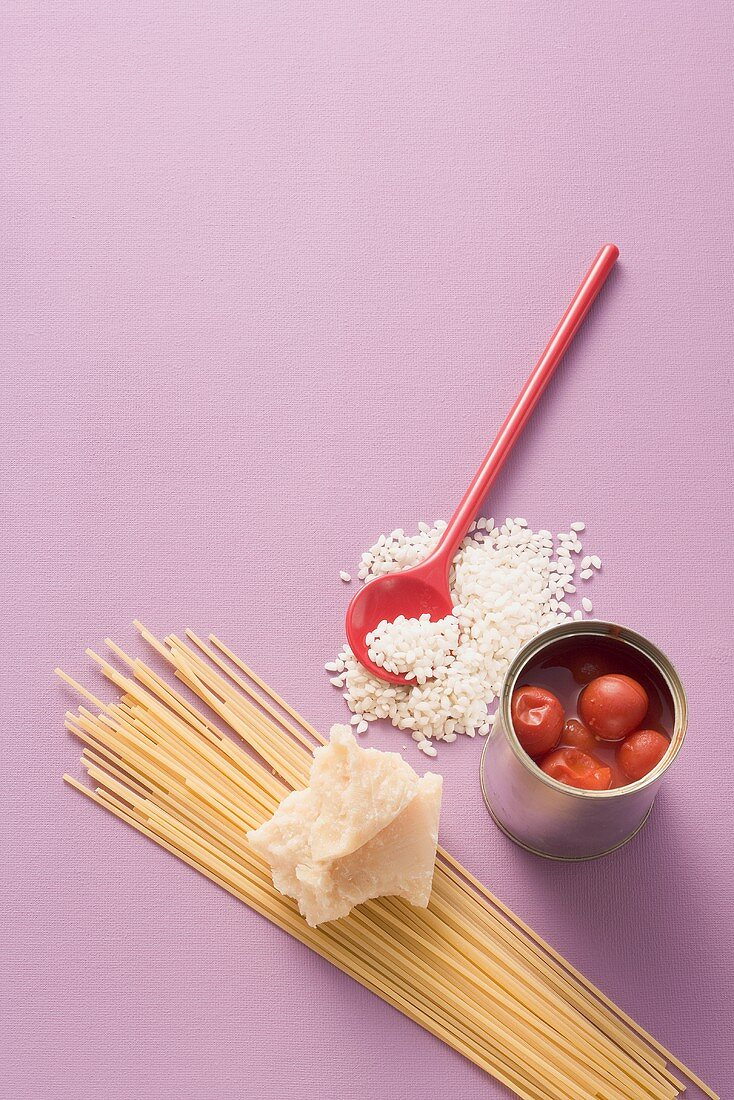 Store cupboard ingredients: risotto rice, tinned tomatoes, spaghetti & Parmesan