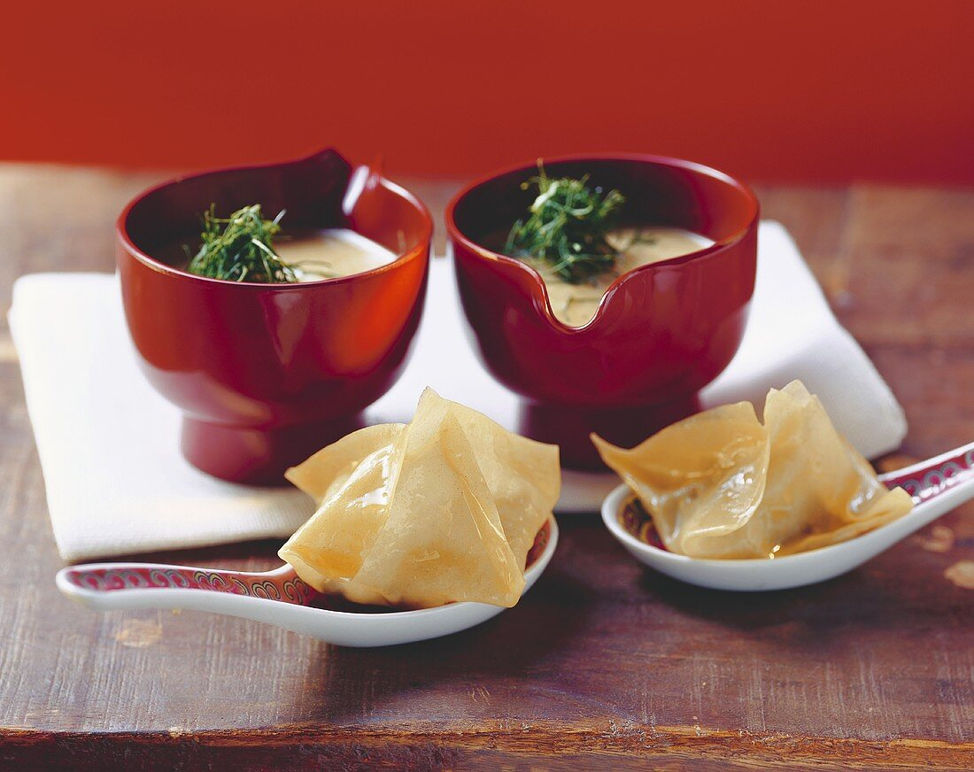 Curried fennel soup with oyster won ton on spoon
