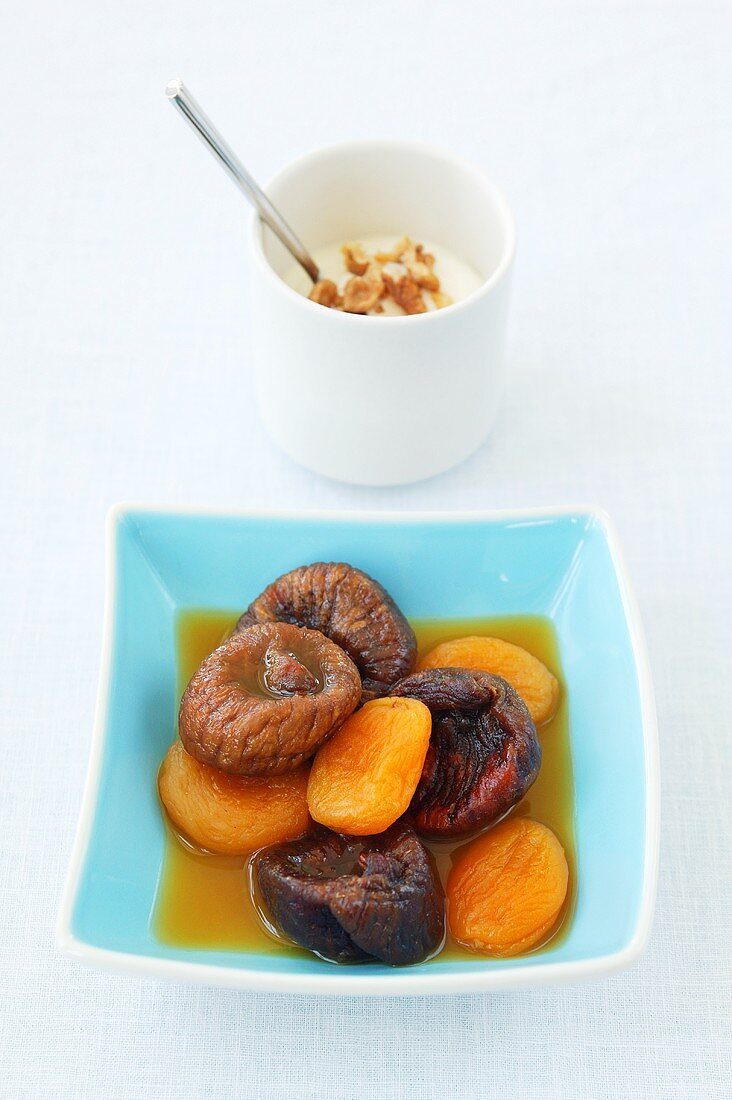 Dried fruit compote (figs, apricots) and yoghurt