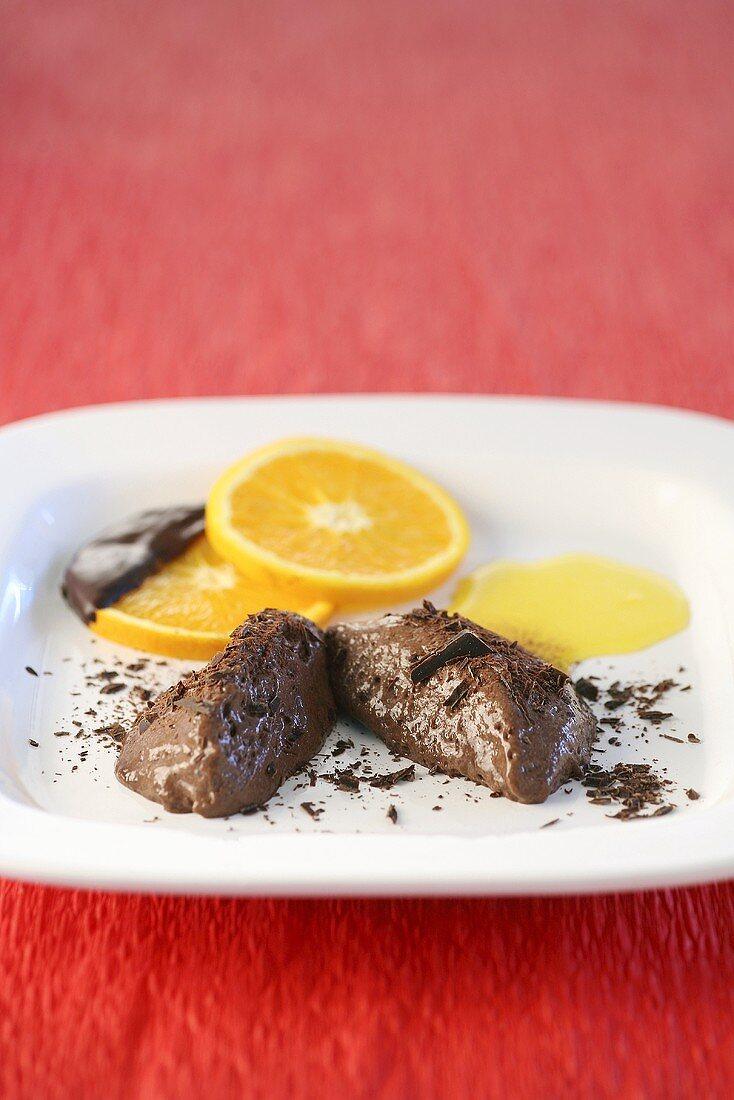 Mousse au chocolat with orange sauce