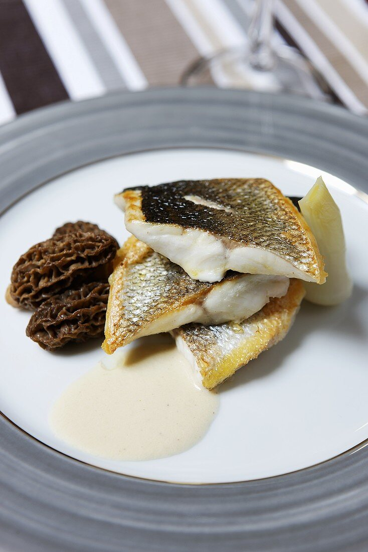 Fried sea bass with morels