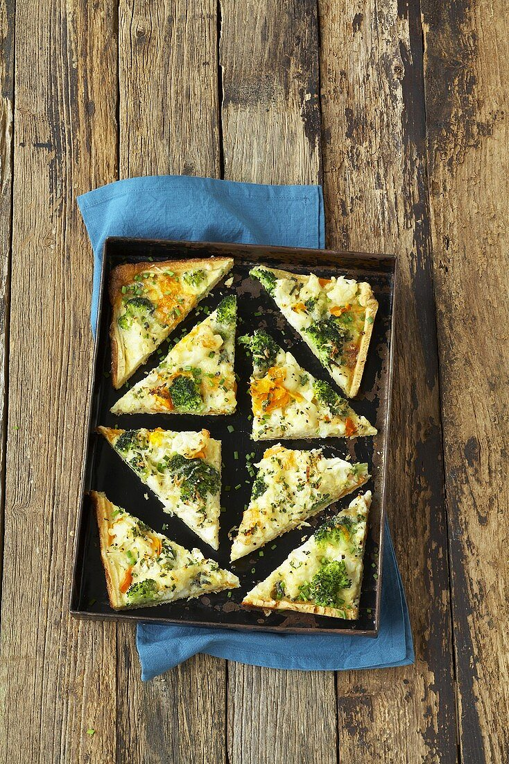 Broccoli and cauliflower tart cut into triangles