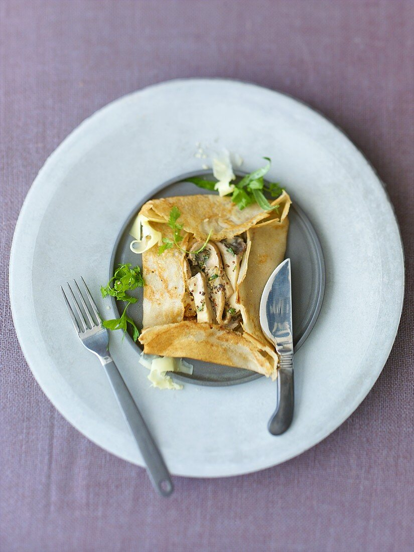 Galette filled with mushroom ragout, herbs
