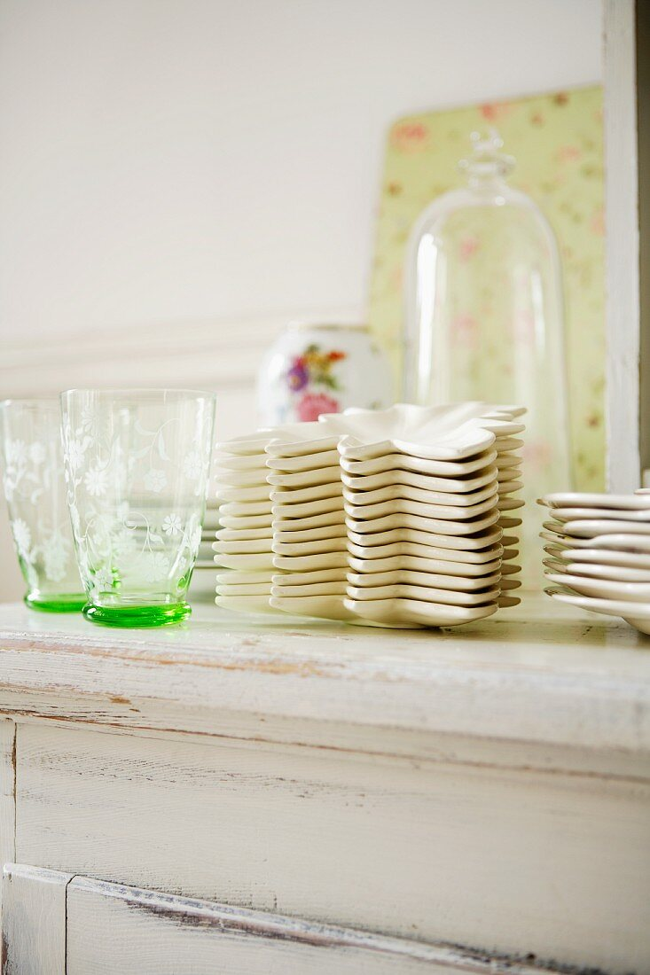 Crockery and glasses on a chest of drawers