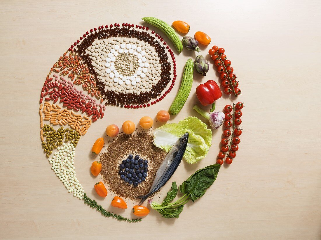 Yin-yang symbol in fresh ingredients and tablets