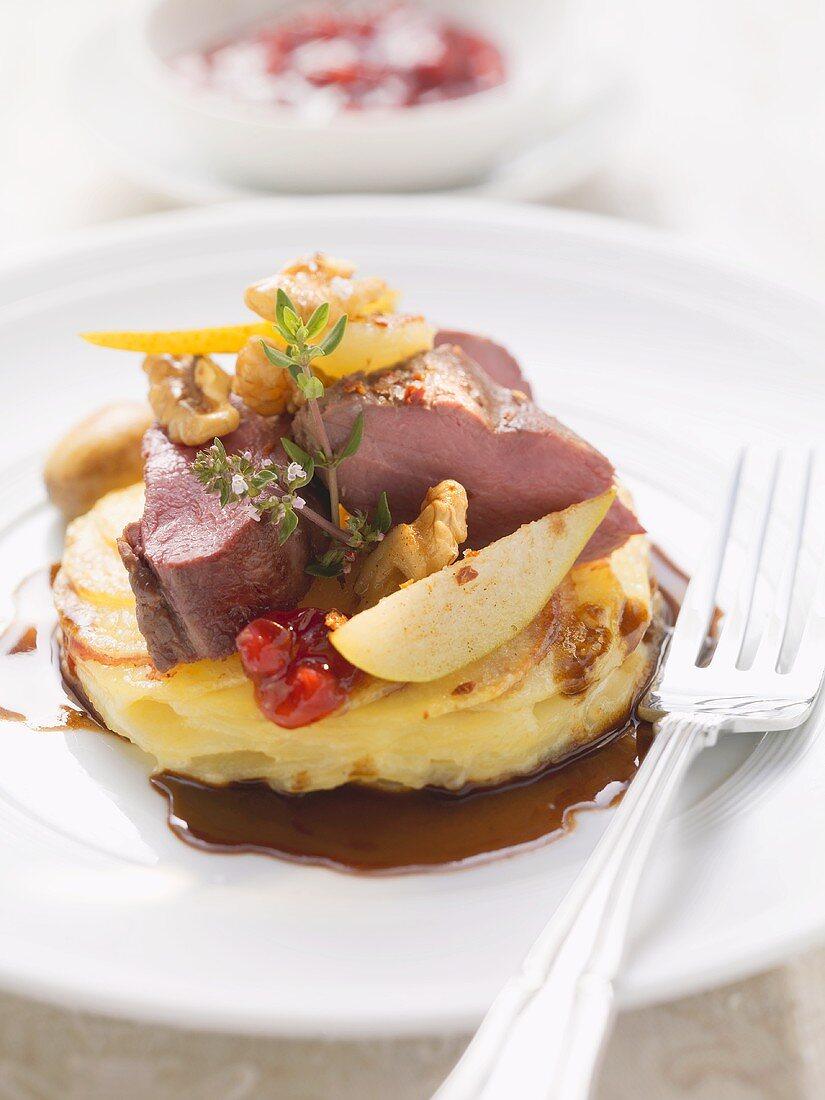 Roast loin of venison (medium) with pear and potato gratin