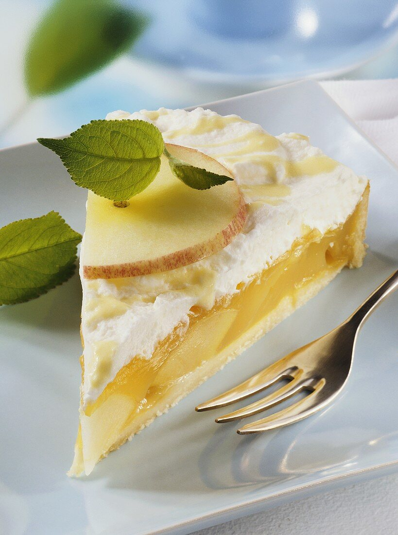 Piece of advocaat cake with apple