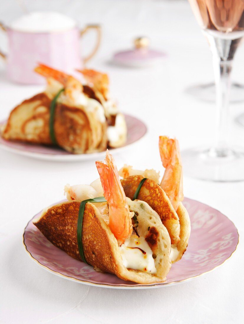 Prawns in pancakes with saffron mayonnaise