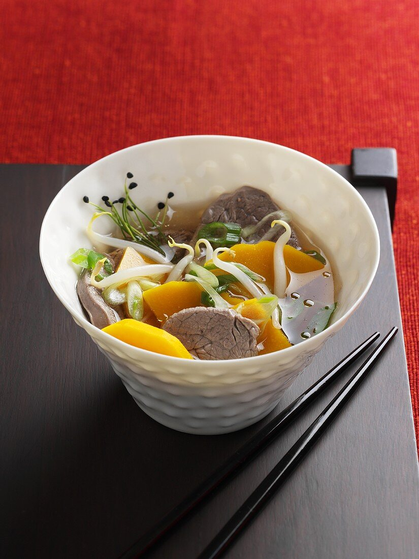 Beef bouillon with pumpkin and soya sprouts