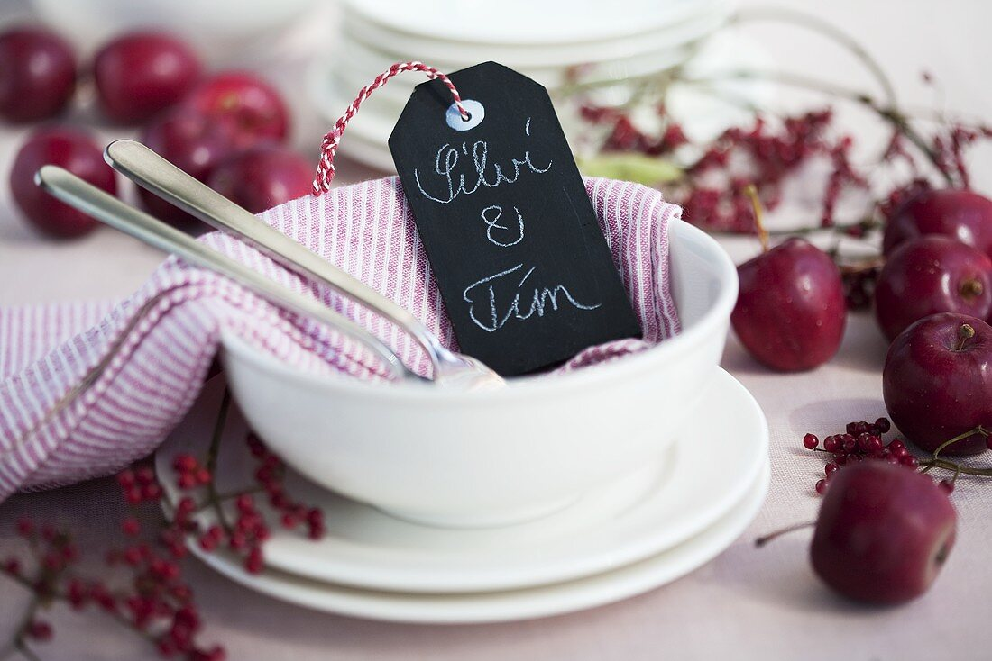 Autumn place-setting with place card, crab apples and berries