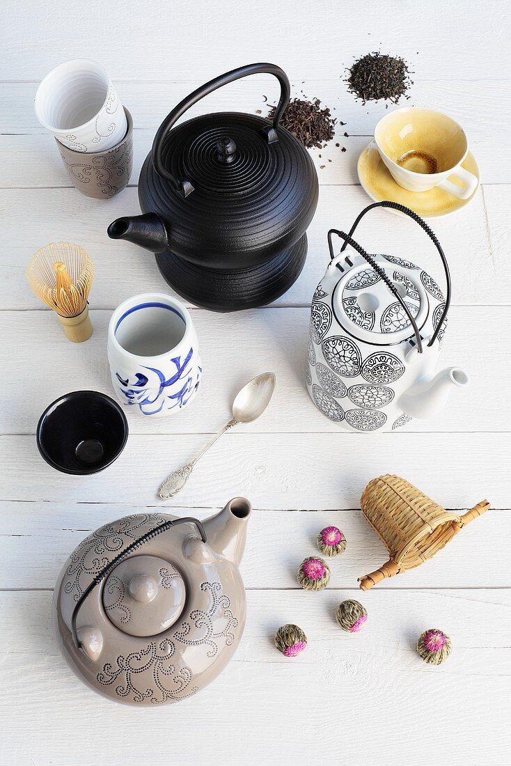 Tea things, tea strainer and tea leaves