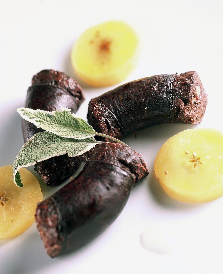 Black pudding with sage and apple slices