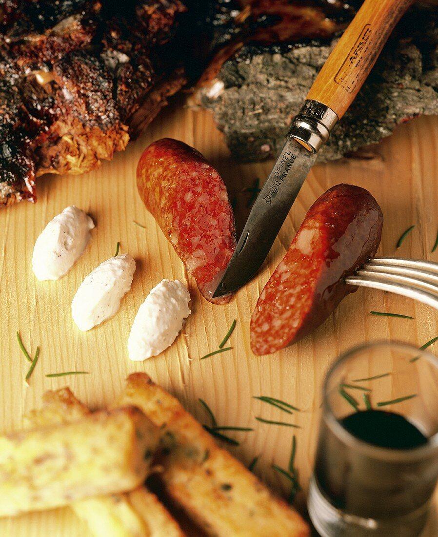 Diot (pork sausage) with pâté, polenta, wine and knife